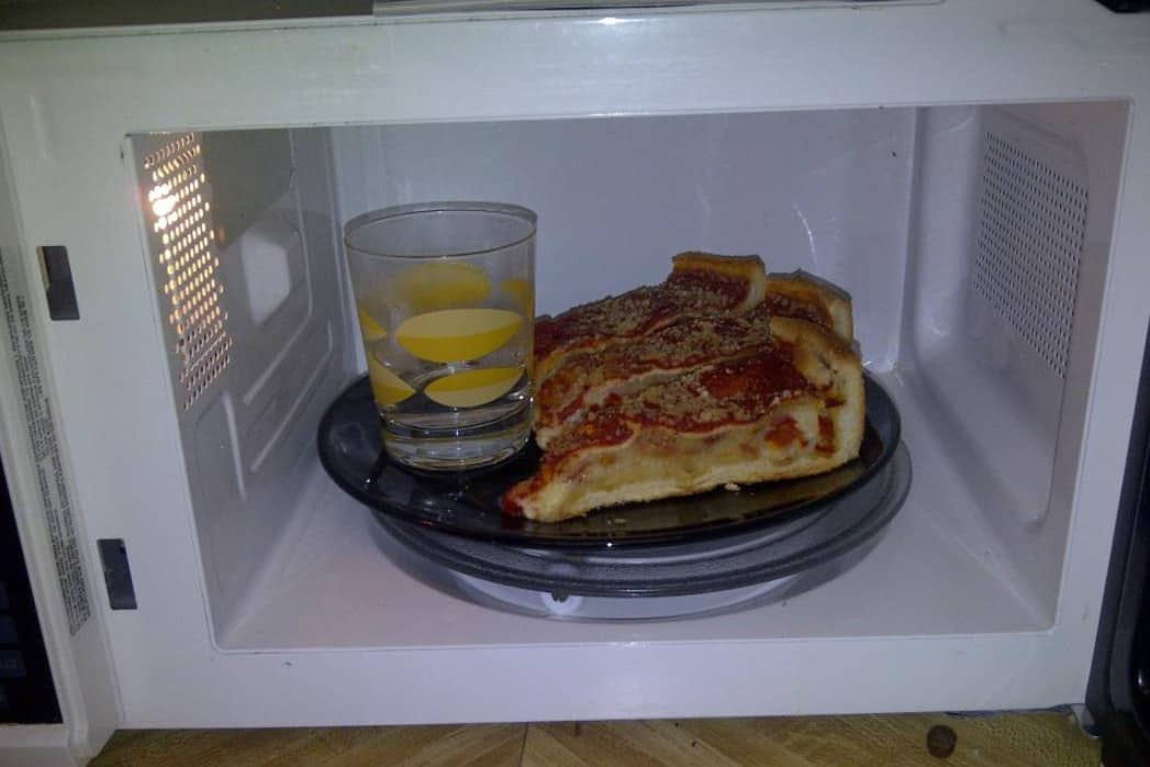 Reheat pizza in the microwave oven
