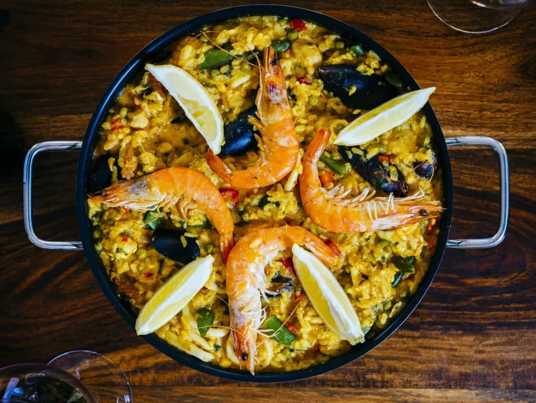 season a paella pan